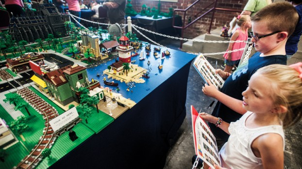 Seven-year-old Madison and her older brother Mason Tieman, 10, take part in the LEGO scavenger event during the LEGO Brick Faire in Portsmouth. (PHOTO ATTRIBUTION: IrontonTribune.com)